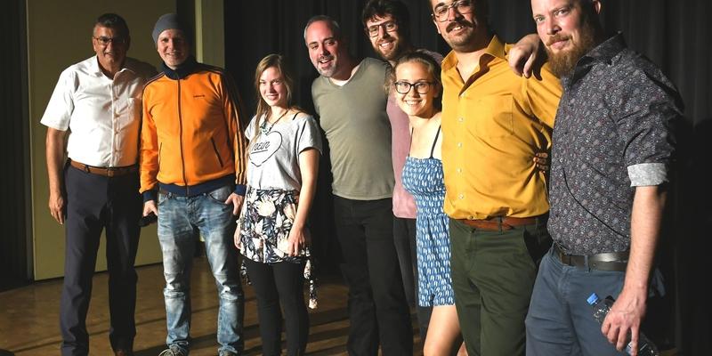 Die Poeten des Wettbewerbs und der redeerfahrene Bürgermeister Stephan Vehreschild